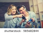 couple playing video game while ... | Shutterstock . vector #585682844