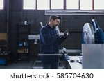 serious craftsman looking at... | Shutterstock . vector #585704630