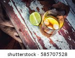 rum with lime and ice in the... | Shutterstock . vector #585707528