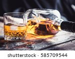 whiskey bottle and glass on a... | Shutterstock . vector #585709544