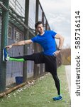 athletic young man stretching... | Shutterstock . vector #585716114