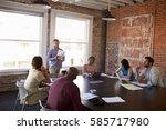 businessman standing to address ... | Shutterstock . vector #585717980