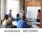 businessman at whiteboard in... | Shutterstock . vector #585722603