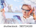 life scientists researching in... | Shutterstock . vector #585724100