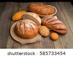fresh fragrant bread on a dark... | Shutterstock . vector #585733454