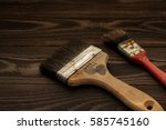 used paint brushes on old dark... | Shutterstock . vector #585745160