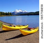 yellow canoes in front of a... | Shutterstock . vector #585758858