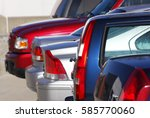 closeup on cars in the parking... | Shutterstock . vector #585770060