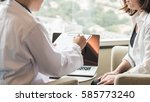 doctor consulting and examining ... | Shutterstock . vector #585773240