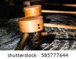 Stock photo ladles used to scoop the water when cleansing yourself before entering a shinto a shrine these 585777644