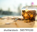 upside down the jar of coins on ... | Shutterstock . vector #585799100