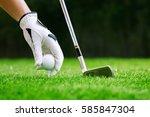 hand putting golf ball on tee... | Shutterstock . vector #585847304