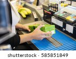 cropped image of cashier... | Shutterstock . vector #585851849