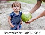 cute little girl drinking... | Shutterstock . vector #585867344