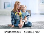 beautiful young woman and her...   Shutterstock . vector #585886700