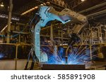 industrial robot is welding... | Shutterstock . vector #585891908