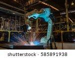 robot is welding assembly... | Shutterstock . vector #585891938