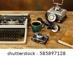 vintage typewriter  cup of... | Shutterstock . vector #585897128
