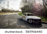 abandoned and burnt out car. a... | Shutterstock . vector #585906440