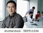 male executive  looking at... | Shutterstock . vector #585911336