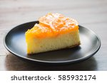 Slice Of Orange Cake On Black...