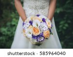 wedding bouquet of flowers in... | Shutterstock . vector #585964040