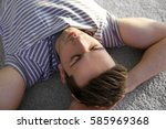 happy young man lying on soft...   Shutterstock . vector #585969368
