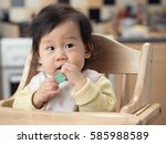 cute baby girl brushing her... | Shutterstock . vector #585988589