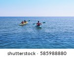 family boat racing. a woman... | Shutterstock . vector #585988880