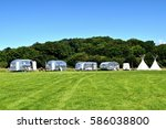 Small photo of Vintage campsite with airstream trailers and teepees