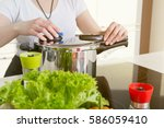 woman uses pressure cooker to... | Shutterstock . vector #586059410