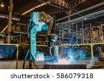 industrial robot welding metal... | Shutterstock . vector #586079318
