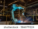 robot welding metal part in car ... | Shutterstock . vector #586079324