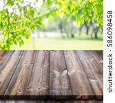 empty wooden table with garden... | Shutterstock . vector #586098458