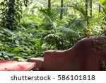 abandoned couch in a forest | Shutterstock . vector #586101818
