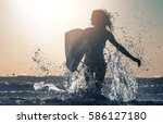 woman smiles and runs into the... | Shutterstock . vector #586127180