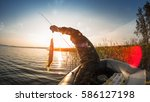 man with fish in the boat on... | Shutterstock . vector #586127198