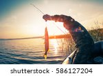 fisherman with fish on the boat ... | Shutterstock . vector #586127204