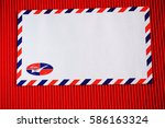 Small photo of Airmail letter envelope on red isolated background
