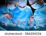 group of surgeons at work in... | Shutterstock . vector #586204256