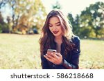 young cheerful woman watching... | Shutterstock . vector #586218668