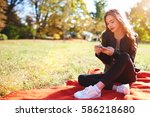 young hipster girl is chatting... | Shutterstock . vector #586218680