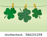 petals of clover with a picture ... | Shutterstock .eps vector #586231298