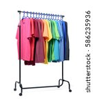 Stock photo mobile rack with color clothes on white background 586235936