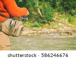 fishing in river.a fisherman... | Shutterstock . vector #586246676