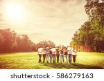 rear view of group of teenage... | Shutterstock . vector #586279163