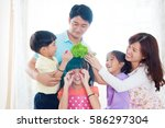 asian family having fun in the... | Shutterstock . vector #586297304