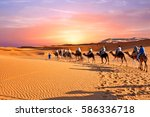 camel caravan going through the ... | Shutterstock . vector #586336718