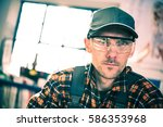 worker in protection goggles...   Shutterstock . vector #586353968