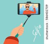 hipster makes selfie on the... | Shutterstock .eps vector #586402709